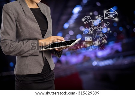Business woman sending email by using digital tablet #315629399