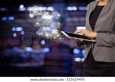 Business woman sending email by using digital tablet #315629495