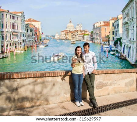 happy couple taking selfie picture in the travel in Venice Italy with the grand canal in the background