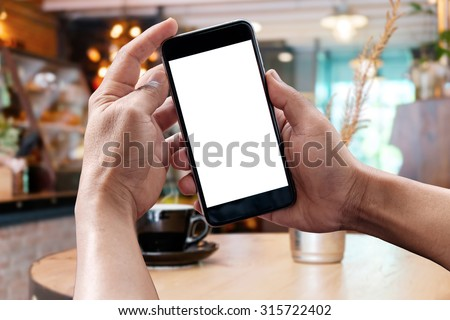 Man hands holding empty screen of smart phone in cefe.  #315722402