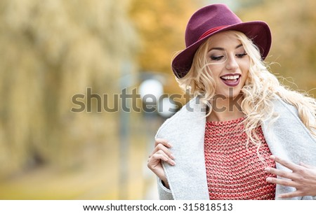 Beautiful elegant woman standing in  autumn park #315818513