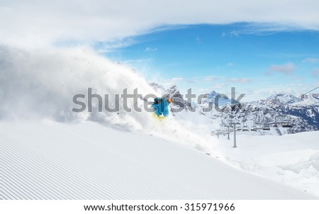 Skier skiing downhill in high mountains #315971966