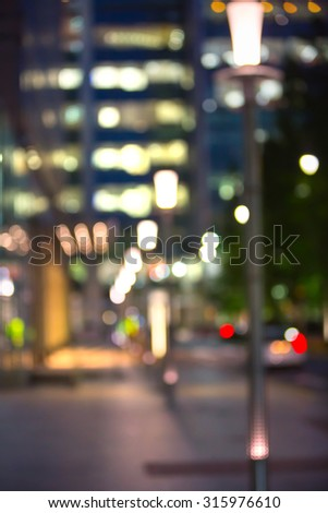City lights blur background. London, Canary Wharf night life. Traffic, roads, lanterns and lit up office buildings #315976610