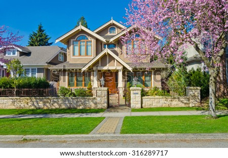 Luxury custom made house at sunny day, cherry blossom, spring time  in Vancouver, Canada. #316289717