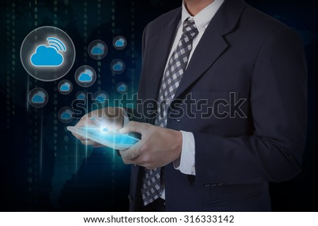 Businessman hand touch screen WiFi cloud icon on a tablet. #316333142