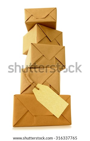 Tall stack or pile of parcels or packages with manila label, low angle view #316337765