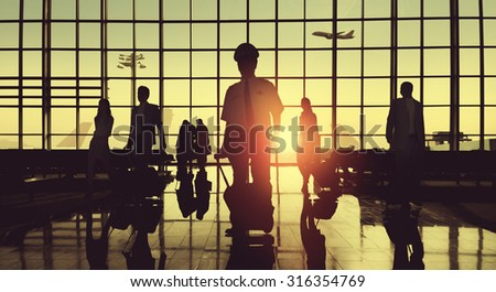 Back Lit Business People Traveling Airplane Airport Concept #316354769