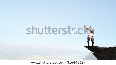 Businessman riding on back of his colleague #316448627