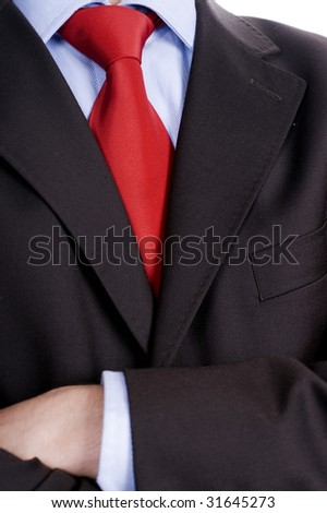 Businessman with his arms crossed isolated #31645273