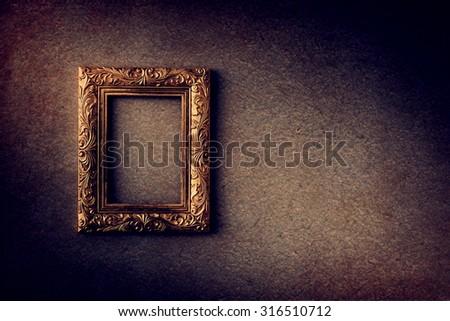 Gold vintage photo frame over grunge background, Still life style