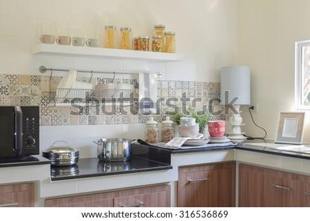 modern ceramic kitchenware and utensils on the black granite counter top #316536869