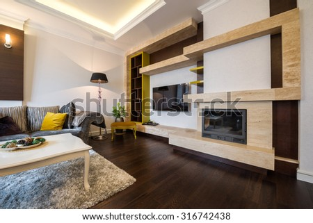 Interior of a living room with fireplace #316742438