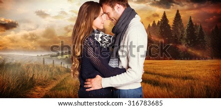 Side view of young couple embracing against country scene #316783685