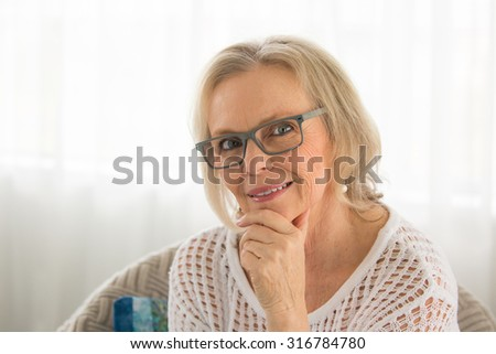 Close up shot of a  beautiful blonde woman relaxing in her chair #316784780