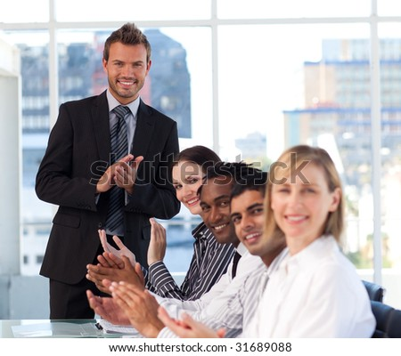 Business people clapping in a meeting #31689088