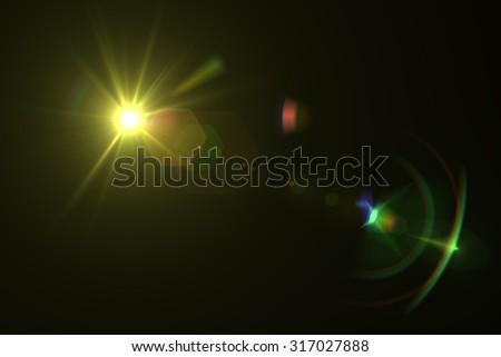 digital lens flare in black background horizontal frame warm #317027888