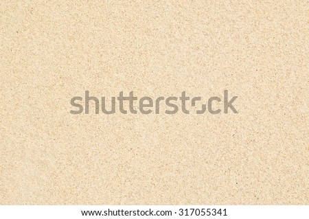 Sand Texture. Brown sand. Background from fine sand. Sand background Royalty-Free Stock Photo #317055341