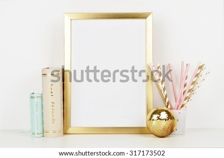 gold picture frame with decorations. Mock up for your photo or text Place your work, print art,shabby style, white background, paper ball, toy, pastel color book