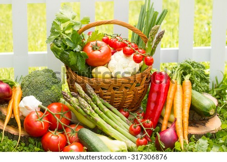 Mix of fresh vegetables in wicker basket  #317306876
