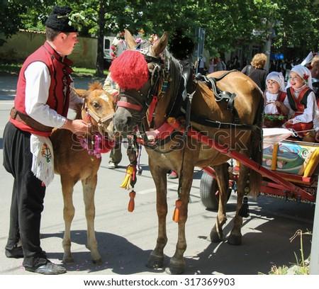 KAZANLAK, BULGARIA - JUNE 7: Participants prepare for the Rose Oil Festival Parade  on June 7, 2015  in Kazanlak, Bulgaria. #317369903