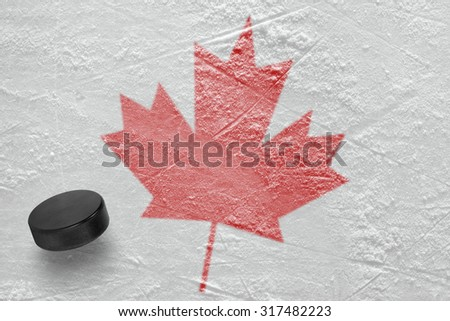 Hockey puck and the image of a maple leaf. Concept
