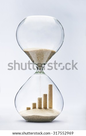 Business growth graphic bar made out of falling sand inside hourglass #317552969