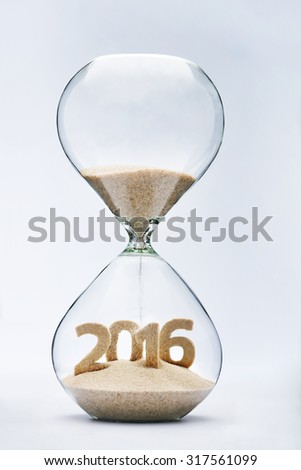 New Year 2016 concept with hourglass falling sand taking the shape of a 2016 #317561099