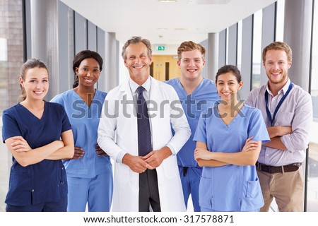 Portrait Of Medical Team Standing In Hospital Corridor Royalty-Free Stock Photo #317578871