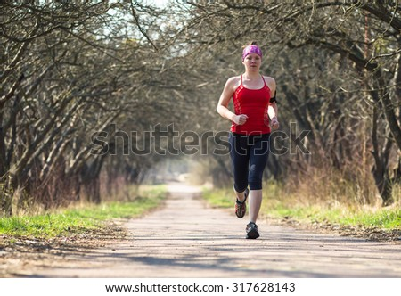 Sport woman jogging outside in autumn morning  #317628143