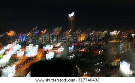 Abstract blurry night light of bangkok city by shaking camera