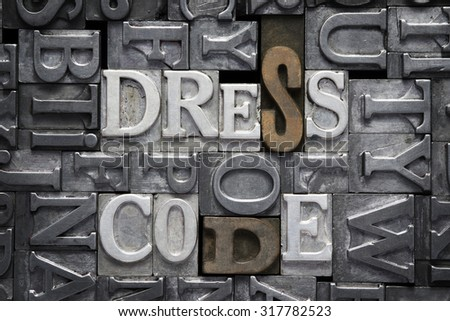 dress code phrase made from metallic letterpress type with letter blocks background #317782523
