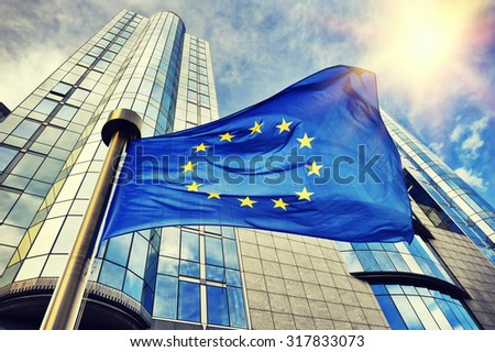 EU flag waving in front of European Parliament building. Brussels, Belgium Royalty-Free Stock Photo #317833073