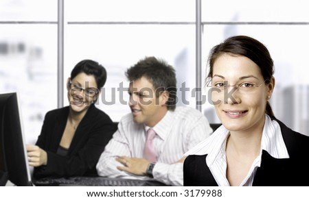 Young businesspeople are working in the office. Selective focus is placed on the woman in the foreground. #3179988