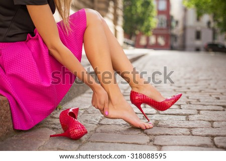 Woman with injured foot Royalty-Free Stock Photo #318088595