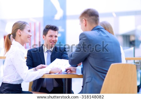 Group of happy young business people in a meeting at office #318148082
