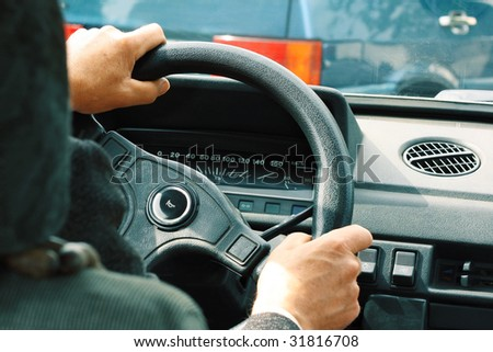 Driver's hands on steering wheel #31816708