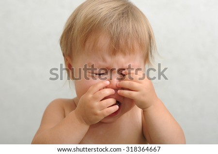 Screaming crying baby rubbing her eyes #318364667