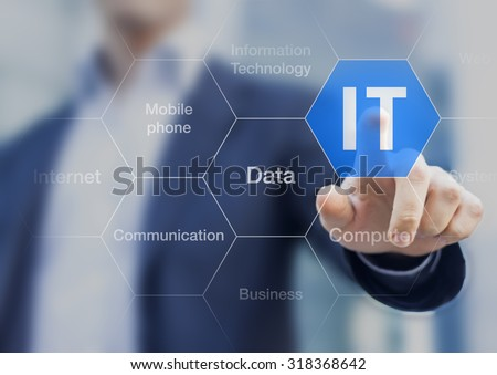 IT consultant presenting tag cloud about information technology Royalty-Free Stock Photo #318368642
