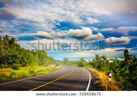 Open road. Beautiful grassland road in Thailand.Highland road .Asphalt road in Chiangmai.  #318458675