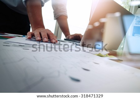 Double exposure of businessman hand working with new modern computer and business strategy as concept Royalty-Free Stock Photo #318471329