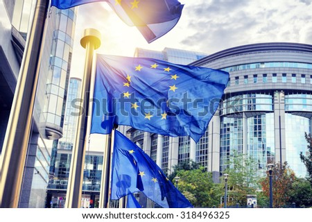 EU flags waving in front of European Parliament building. Brussels, Belgium #318496325