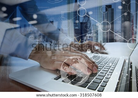 businessman hand working with modern technology and digital layer effect as business strategy concept #318507608