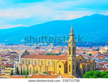 panoramic view of Santa Croce cathedral in Florence, Italy #318755708