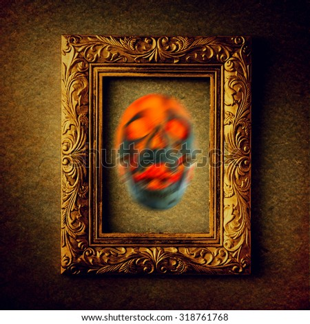 Gold vintage photo frame with soul of skull over grunge background, black and white, halloween concept