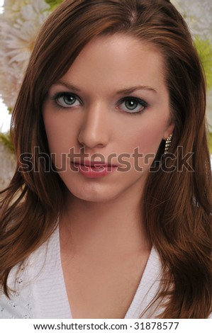 Young woman portrait with flowers on the background #31878577