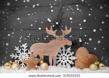 Christmas Card With Golden Festive Decoration On Snow. White Moose, Christmas Ball, Hear, Snowflakes, Star. Gray, Rustic, Vintage Wooden Background. Copy Space For Advertisement. Black And White Image