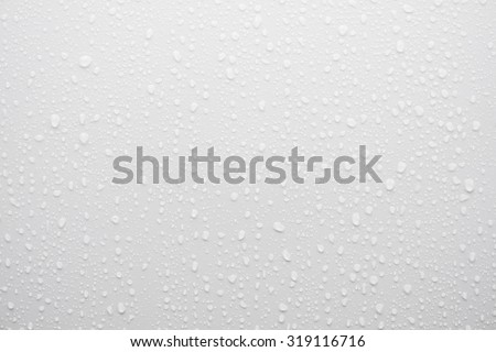 water drop on white surface as background Royalty-Free Stock Photo #319116716