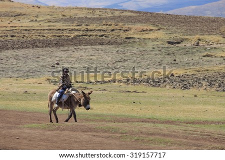 """Semonkong-SEPT 19:Basotho man wearing traditional blanket on a horse September 19,2015 in Semonkong,Lesotho. The horse is """"Basuto"""" a pony breed from Lesotho and SA they are popular in the mountains #319157717"""