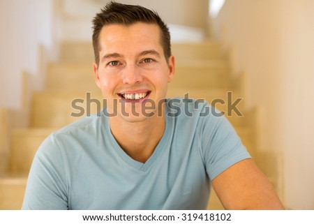 portrait of smiling man relaxing at home #319418102