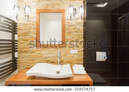 Picture of decorative light stone wall in new bathroom